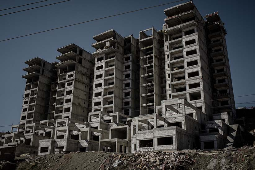 Unfinished buildings in Sulaymaniyah, Kurdistan, Iraq. Construction projects across Iraqi Kurdistan have ground to a halt as Kurdistan's economy falls further into crisis. Unfinished buildings dot the landscape in cities across the region. (Photograph by Cengiz Yar)